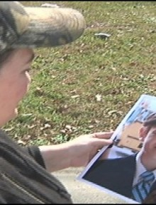 Nick Taylor's mom holds a picture of her son